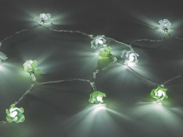 Lichterkette 120cm Blumen weiss + grün sort. Mit 10 LED-Lämpchen warm-weiss leuchtend; mit Batterieb